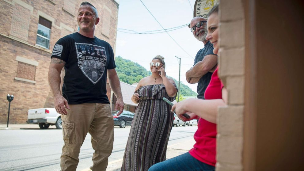 Richard Ojeda, left, stands outside his campaign headquarters in Logan, West Virginia alongside his communications director Madalin Sammons, center, and campaign volunteer Heather Ritter, right, July 5, 2018. Ojeda is a first-term lawmaker from southern West Virginia running to represent the states 3rd Congressional District as a Democrat.