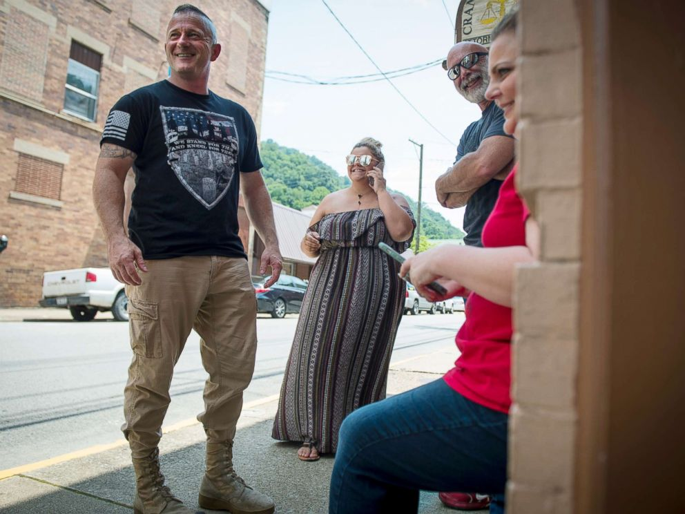 PHOTO: Richard Ojeda, left, stands outside his campaign headquarters in Logan, West Virginia alongside his communications director Madalin Sammons, center, and campaign volunteer Heather Ritter, right, July 5, 2018.