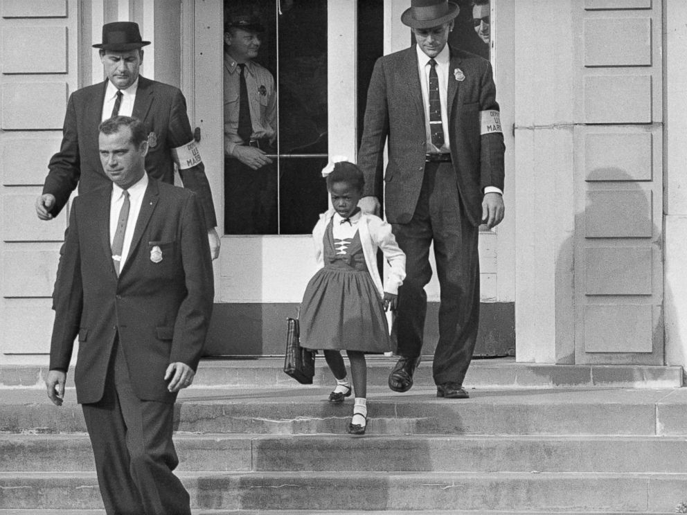 PHOTO: U.S. Deputy Marshals escort 6-year-old Ruby Bridges from William Frantz Elementary School in New Orleans, in November 1960.