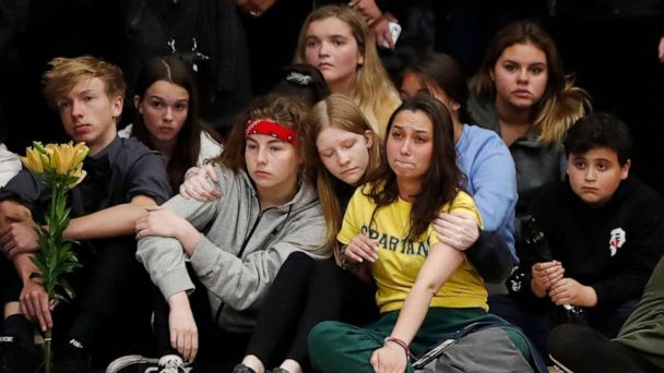 Colorado students walk out as school shooting vigil turns political
