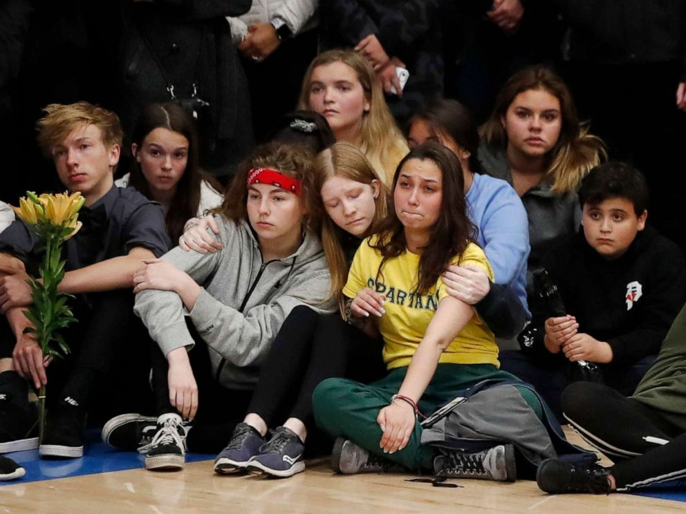 PHOTO: Young people console each other during a community vigil to honor the victims and survivors of a fatal shooting at the STEM School Highlands Ranch, late Wednesday, May 8, 2019, in Highlands Ranch, Colo.