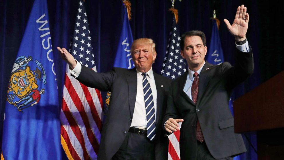 Republican presidential nominee Donald Trump is welcomed to the stage by Wisconsin Governor Scott Walker during a campaign rally at the W.L. Zorn Arena, Nov. 1, 2016 in Altoona, Wis.