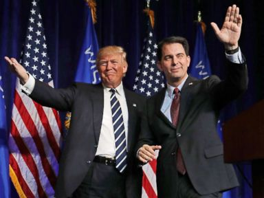 PHOTO: Republican presidential nominee Donald Trump is welcomed to the stage by Wisconsin Governor Scott Walker during a campaign rally at the W.L. Zorn Arena, Nov. 1, 2016 in Altoona, Wisc.