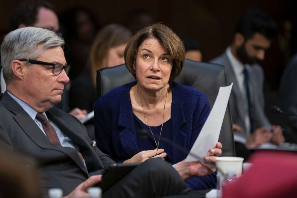 Senate Judiciary Committee member Sen. Amy Klobuchar, D-Minn., joined at left by Sen. Sheldon Whitehouse, D-R.I., prepares to vote against advancing William Barr's nomination for attorney general, as the panel meets on Capitol Hill in Washington, Feb. 7, 2019.