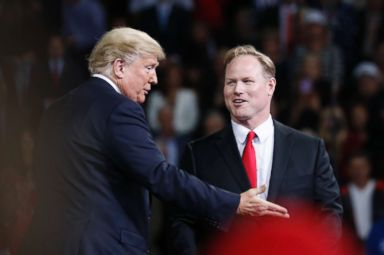 PHOTO: President Donald Trump, left, talks with Republican candidate for Kansas 2nd Congressional District Steve Watkins during a campaign rally at Kansas Expocentre, Oct. 6, 2018 in Topeka, Kan.