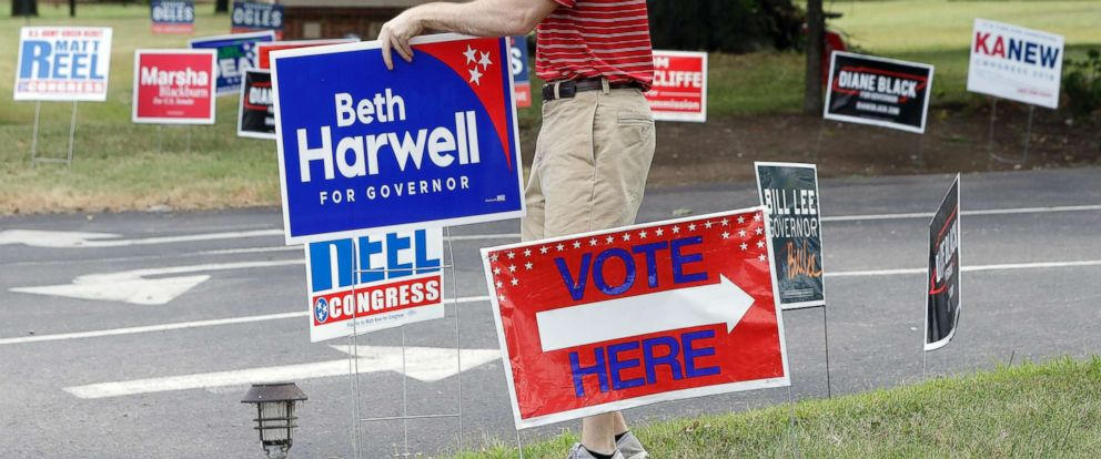 PHOTO: Jacob Baggett places a campaign sign at a polling place, Aug. 2, 2018, in Brentwood, Tenn.