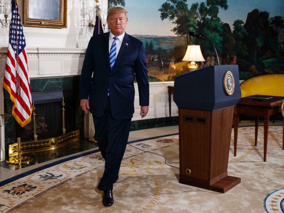 PHOTO: Donald Trump walks off after delivering a statement on the Iran nuclear deal from the Diplomatic Reception Room of the White House, May 8, 2018.