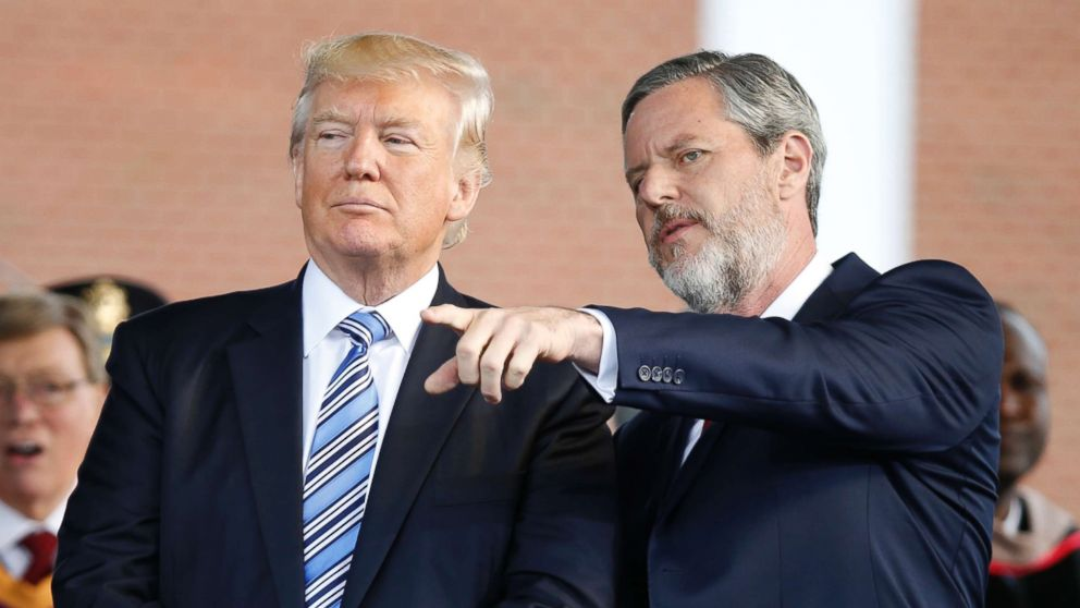 President Donald Trump stands with Liberty University President Jerry Falwell Jr. in Lynchburg, Va., on May 13, 2017.