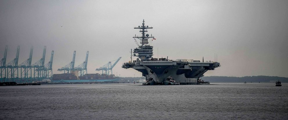 PHOTO: The aircraft carrier USS George H.W. Bush transits the Elizabeth River near Norfolk, Va., Feb. 21, 2019.