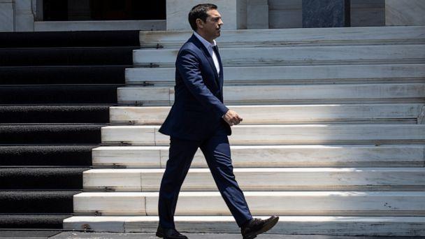 Greek leader warns of return to 'dark days' of austerity
