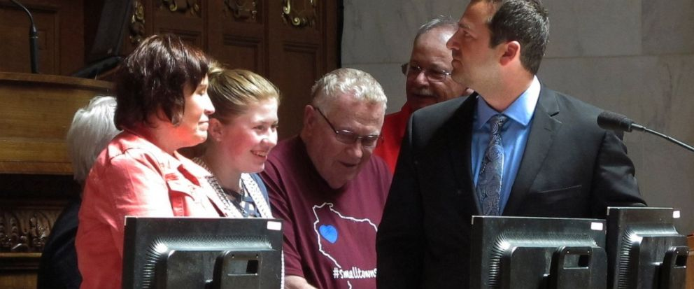 "Kidnapping victim Jayme Closs, second from left, appears with her family and supporters to receive a ""hometown hero"" award from the Wisconsin Assembly on Wednesday, May 15, 2019, in Madison, Wis. Closs escaped in January after her parents were killed"