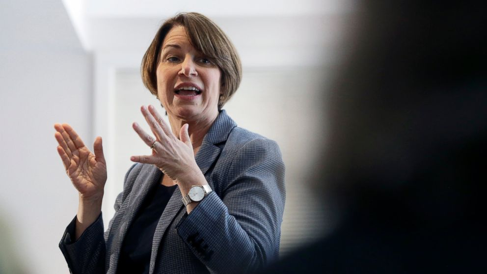 In this Sunday, Feb. 24, 2019, photo, U.S. Sen. Amy Klobuchar, D-Minn., speaks to voters during a campaign stop at a home in Nashua, N.H. U.S. Sen. and presidential hopeful Klobuchar has built a reputation as an effective champion for consumer safety. She also aggressively advocated for the medical device industry - a big employer in her home state of Minnesota - in ways that complicate her reputation as a consumer defender. Some consumer advocates say her work has helped put patients at risk. (AP Photo/Steven Senne)