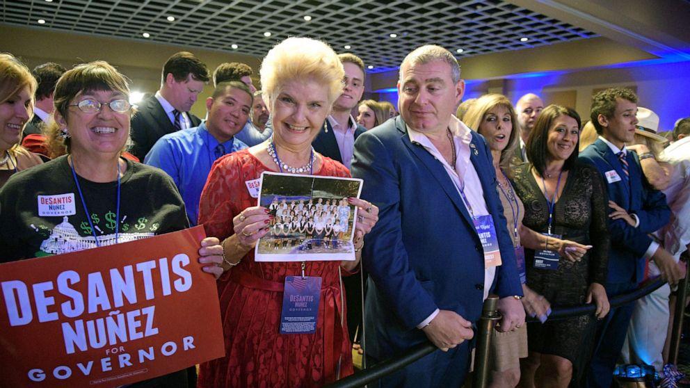 Photos show Rudy Giuliani's fixers with Florida governor