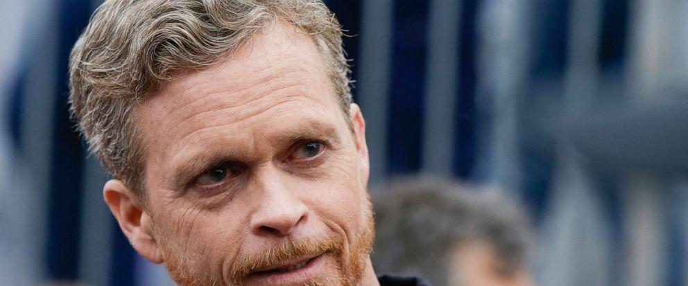 FILE - In this May 6Nike CEO and President Mark Parker talks at the finish line of a 2 hours marathon, at the Monza Formula One racetrack, Italy, Saturday, May 6, 2017. Parker has found himself at the center of doping scandal that has brought down re