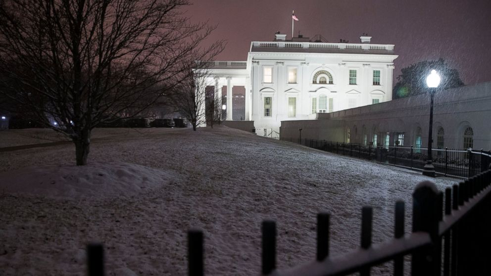 Snow falls on the White House as a winter storm arrives in the region, Saturday, Jan. 12, 2019, in Washington. (AP Photo/Alex Brandon)