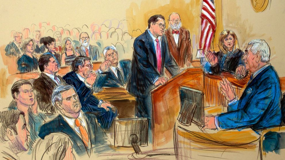 This courtroom sketch shows former campaign adviser for President Donald Trump, Roger Stone talking from the witness stand as prosecution attorney Jonathan Kravis, standing left, Stone's attorney Bruce Rogow, third from right, and Judge Amy Berman Jackson listen, during a court hearing at the U.S. District Courthouse in Washington, Thursday, Feb. 21, 2019. Berman Jackson issued a broad gag order forbidding Stone to discuss his criminal case with anyone and gave him a stinging reprimand over his posting of a photo of the judge with what appeared to be crosshairs of a gun. (Dana Verkouteren via AP)