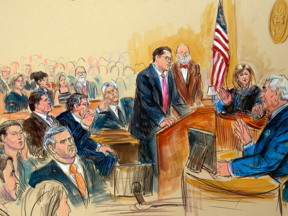 This courtroom sketch shows former campaign adviser for President Donald Trump, Roger Stone talking from the witness stand as prosecution attorney Jonathan Kravis, standing left, Stones attorney Bruce Rogow, third from right, and Judge Amy Berman Ja