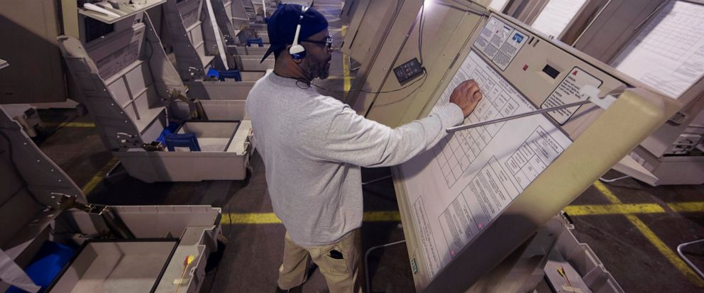 FILE- In this Oct. 14, 2016 file photo, a technician works to prepare voting machines to be used in an upcoming election in Philadelphia. On Friday July 5, 2019, Pennsylvania Gov. Tom Wolf vetoed legislation that carried $90 million to help counties