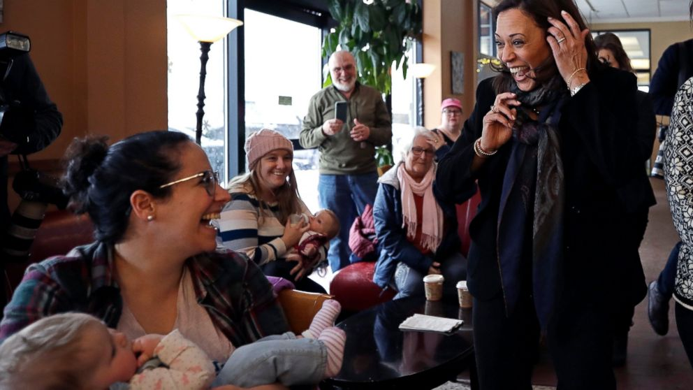 Democratic presidential candidate Sen. Kamala Harris, D-Calif., greets Emily Ragsdale and her baby, Noa, at Gibson's Bookstore & Cafe during a campaign stop, Monday, Feb. 18, 2019, in Concord, N.H. (AP Photo/Elise Amendola)