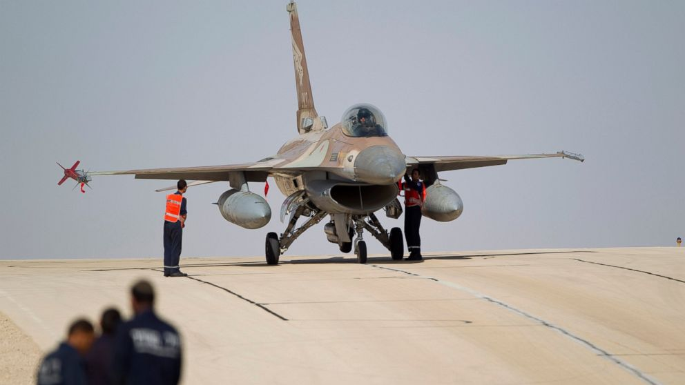 FILE - In this Nov. 25, 2013 file photo, Israeli air force technicians check an Israeli air force plane F-16 of the Red Dragon squadron at Ovda airbase near Eilat, southern Israel. Croatia's defense minister says Israel has failed to overcome U.S. objections to a plan to sell 12 used fighter jets to Croatia and the $500 million deal will likely be canceled. Damir Krsticevic spoke after a meeting with Israeli defense officials in Zagreb on Thursday, Jan. 10, 2019. (AP Photo/Ariel Schalit, file)