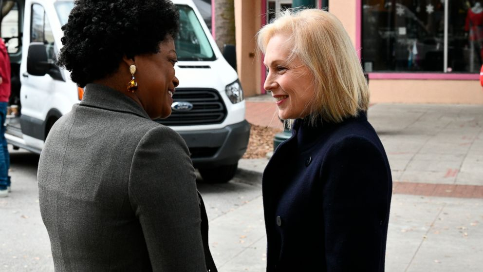 U.S. Sen. Kirsten Gillibrand talks with Jennifer Clyburn Reed ahead of a women's luncheon Reed hosted for her in Columbia, S.C, on Saturday, Feb. 9, 2019. The New York Democrat is spending three days in the critical early-voting state of South Carolina as she explores a 2020 run for president. (AP Photo/Meg Kinnard)