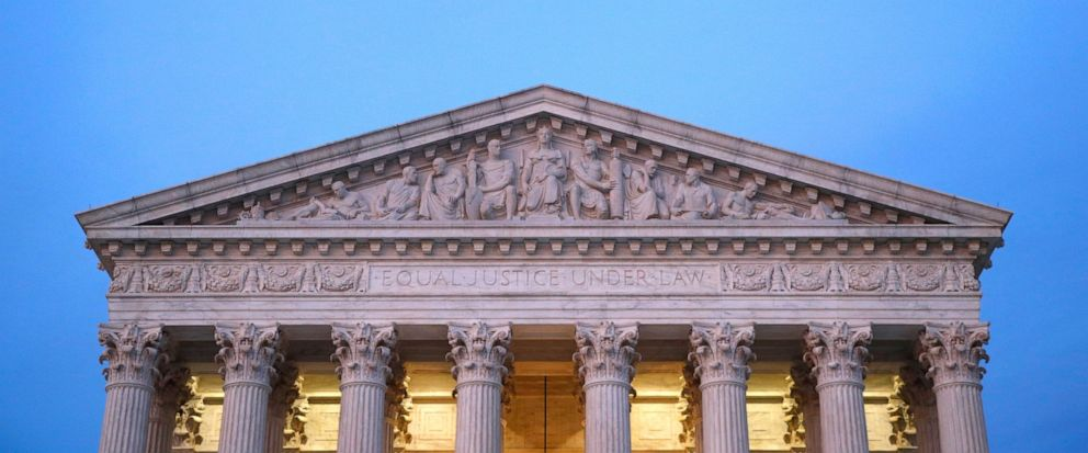 In this May 23, 2019, photo, the U.S. Supreme Court building at dusk on Capitol Hill in Washington. Virginia is holding legislative elections Tuesday, but a case awaiting a Supreme Court ruling could, in an unlikely scenario, result in revisions to a