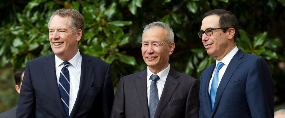 Chinese Vice Premier Liu He accompanied by U.S. Trade Representative Robert Lighthizer, left, and Treasury Secretary Steven Mnuchin, greets the media before a minister-level trade meetings at the Office of the United States Trade Representative in Wa