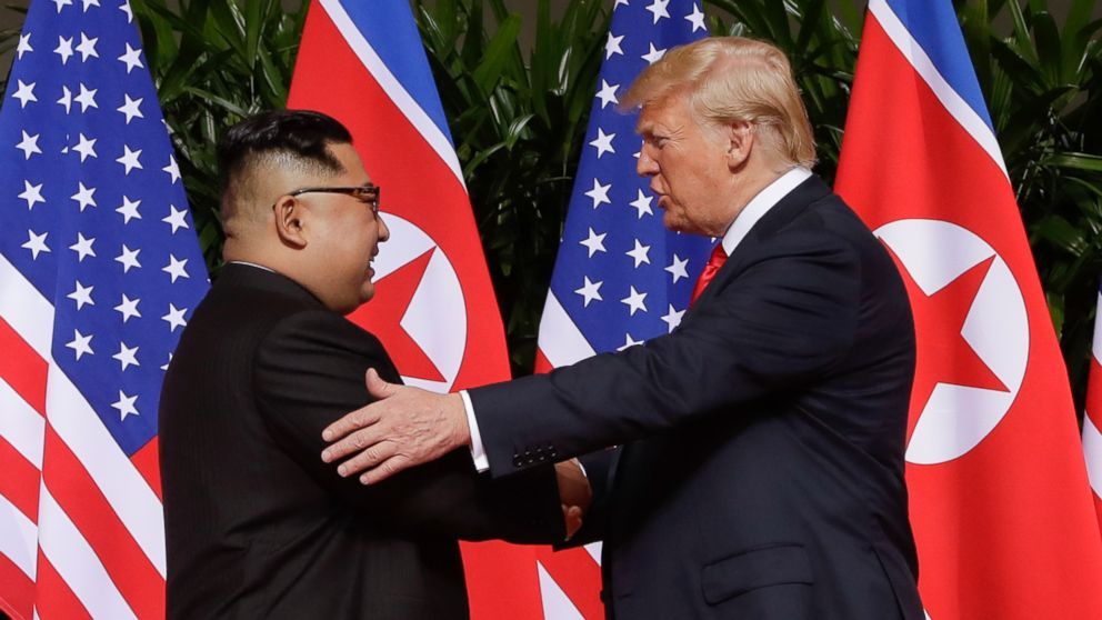 FILE - In this June 12, 2018 file photo, President Donald Trump shakes hands with North Korea leader Kim Jong Un at the Capella resort on Sentosa Island in Singapore. As he prepares to meet again North Korea's Kim Jong Un, President Donald Trump is replaying many of the same moves, with a suspenseful buildup, make-or-break stakes and dramatic rendezvous in a far-flung locale. But the reality-star president is about to learn if the sequel can compete with the original. (AP Photo/Evan Vucci, File)