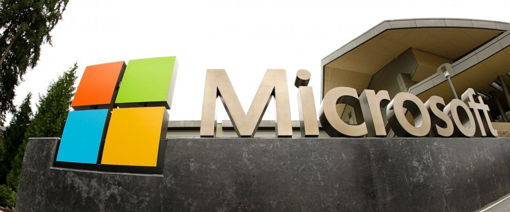 FILE - This July 3, 2014, file photo, shows the Microsoft Corp. logo outside the Microsoft Visitor Center in Redmond, Wash. Microsoft says hackers linked to the Iranian government have targeted a U.S. presidential campaign, as well as government offi