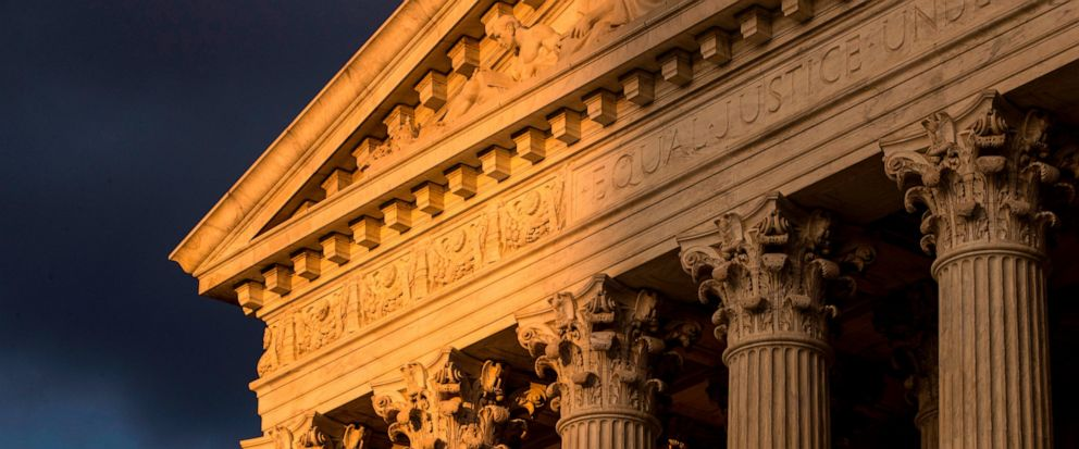 FILE - In this Oct. 10, 2017, file photo, the Supreme Court in Washington is seen at sunset. The Supreme Court is allowing nationwide enforcement of a new Trump administration rule that prevents most Central American immigrants from seeking asylum in