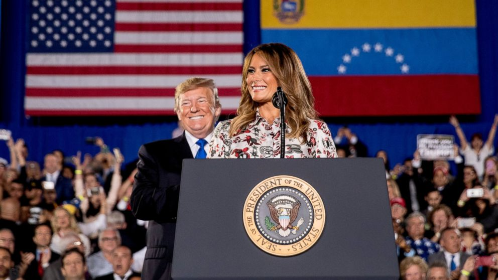 First lady Melania Trump, accompanied by President Donald Trump, smiles as she speaks in front of a Venezuelan American community at Florida Ocean Bank Convocation Center at Florida International University in Miami, Fla., Monday, Feb. 18, 2019, as Trump speaks out against President Nicolas Maduro's government and its socialist policies. (AP Photo/Andrew Harnik)