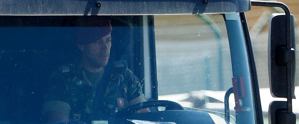 A soldier drives a jet fuel tanker truck at a fuel depot in Aveiras, outside Lisbon, Tuesday, Aug. 13, 2019. Soldiers are driving tanker trucks to distribute gas in Portugal as an open-ended truckers strike over pay enters its second day. The govern