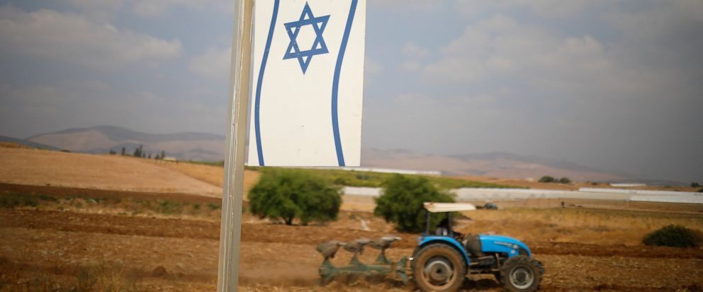 A Palestinian man works on a farm near Bardala, in the Israeli-occupied West Bank, Wednesday, Sept. 11, 2019. Israeli Prime Minister Benjamin Netanyahu's election eve vow to annex the Jordan Valley if he is re-elected has sparked an angry Arab rebuke