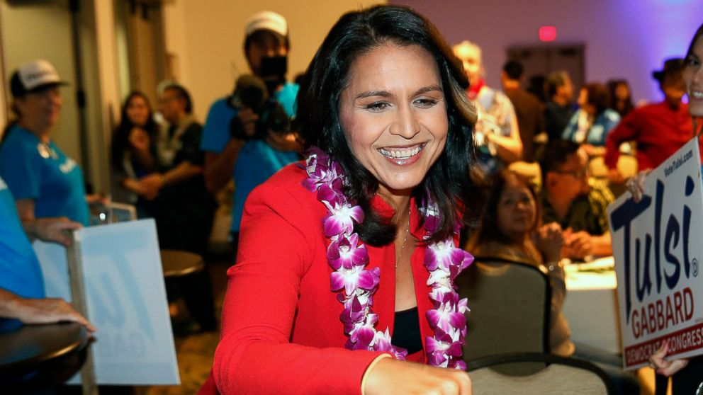 FILE - This Nov. 6, 2018 file photo shows U.S. Rep. Tulsi Gabbard, a Democrat from Hawaii, greeting supporters in Honolulu. Presidential hopeful U.S. Rep. Tulsi Gabbard plans to kick off her campaign with a rally in her home state of Hawaii this weekend. (AP Photo/Marco Garcia, File)