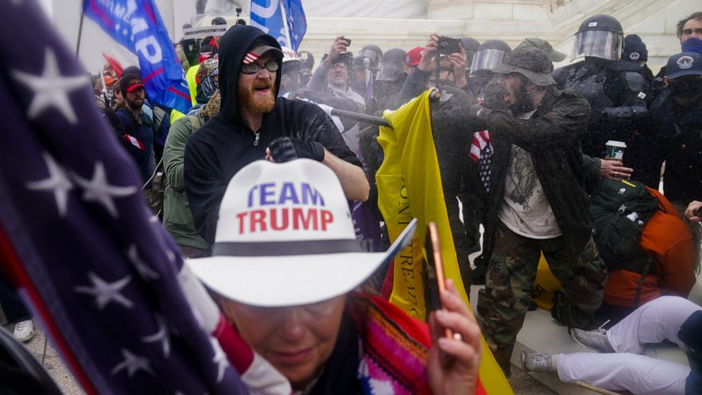 Capitol rally seeks to rewrite Jan. 6 by exalting rioters