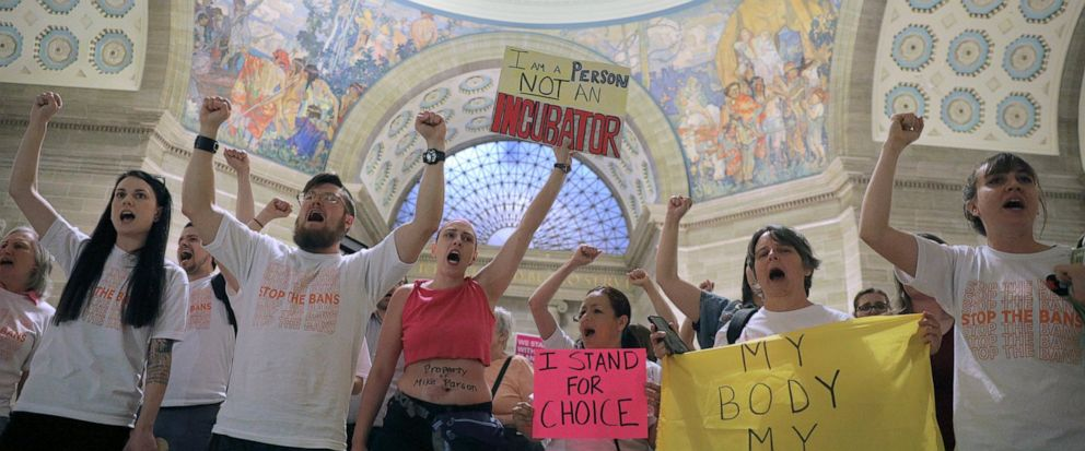 Abortion-rights activists react after lawmakers approved a sweeping piece of anti-abortion legislation, a bill that would ban most abortions in the state of Missouri, Friday, May 17, 2019 in Jefferson, Mo. If enacted, the ban would be among the most