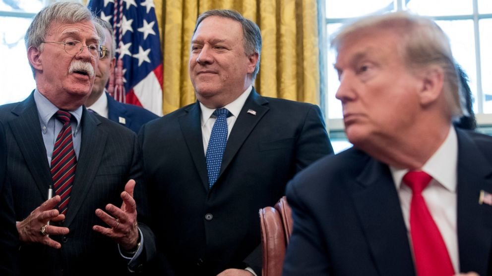 """From left, National Security Adviser John Bolton, accompanied by Secretary of State Mike Pompeo, and President Donald Trump, speaks before Trump signs a National Security Presidential Memorandum to launch the """"Women's Global Development and Prosperity"""" Initiative in the Oval Office of the White House in Washington, Thursday, Feb. 7, 2019. (AP Photo/Andrew Harnik)"""