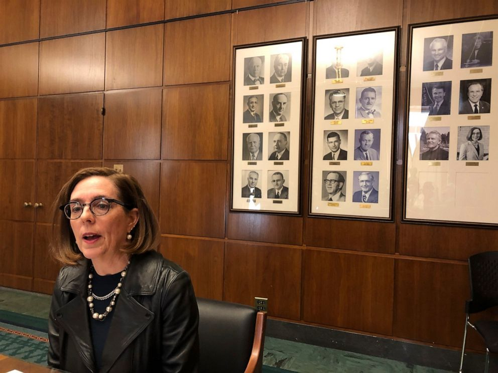 In this Feb. 7, 2019, file photo, Oregon Gov. Kate Brown speaks to reporters in front of pictures of previous state governors in Salem, Ore.