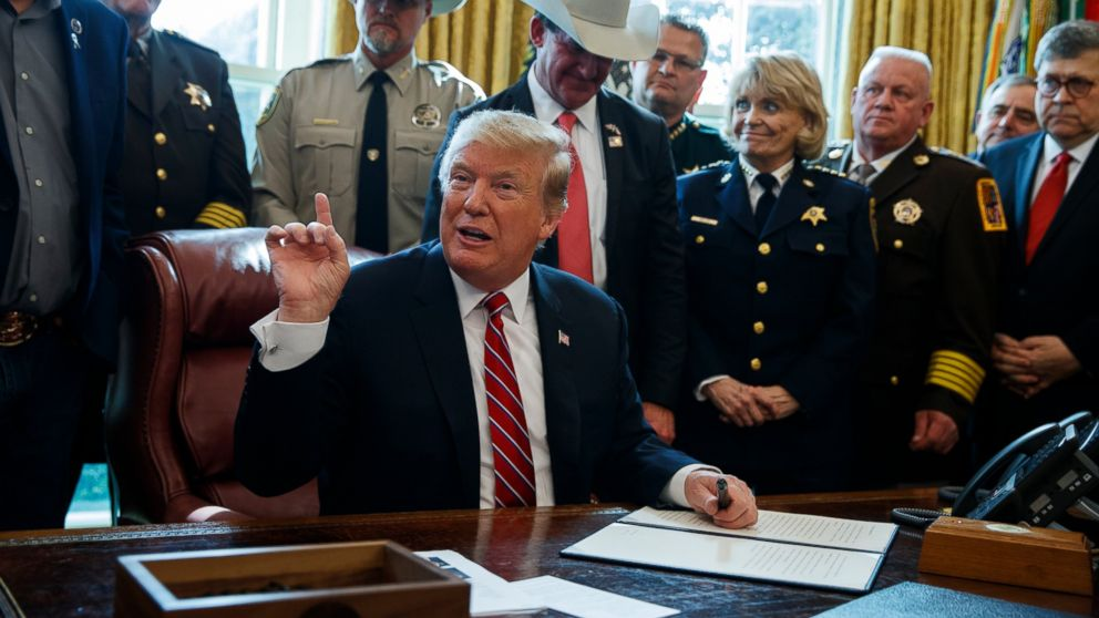 AP FACT CHECK: Trump plays down white nationalist threat