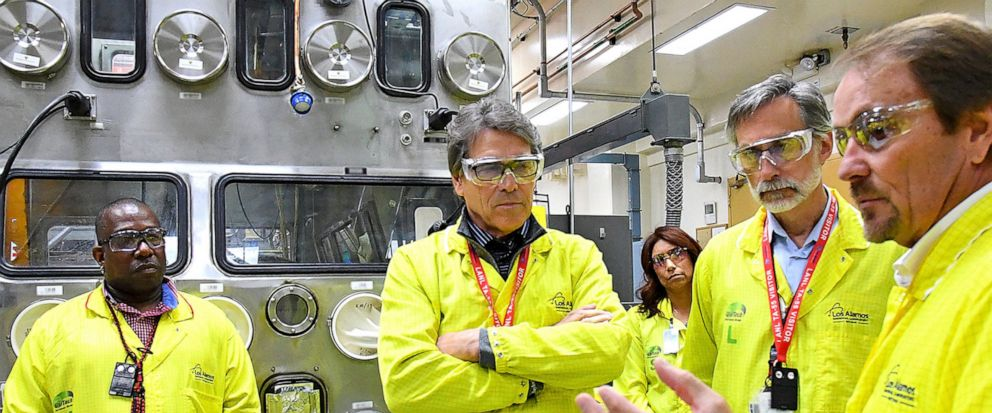 FILE - In this May 10, 2017, file photo provided by the Los Alamos National Laboratory, U.S. Secretary of Energy Rick Perry, second from left, accompanied by Laboratory Director Charlie McMillan, second from right, learns about capabilities at the Lo