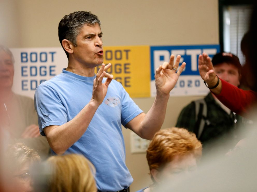 A protester shouts as 2020 Democratic presidential candidate, South Bend Mayor Pete Buttigieg speaks during a town hall meeting, Tuesday, April 16, 2019, in Fort Dodge, Iowa.