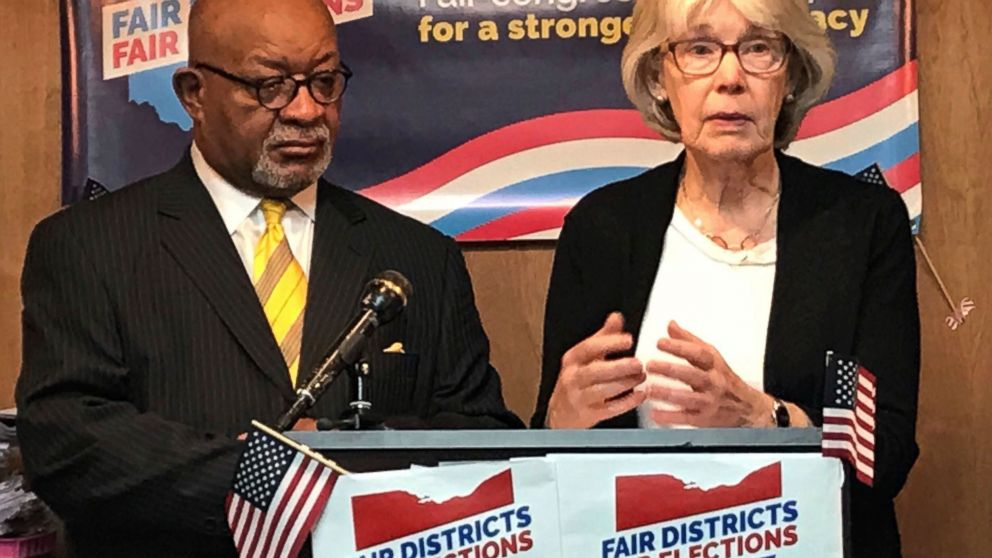 "File-In this Jan. 22, 2018, file photo, fair Congressional Districts for Ohio members Ann Henkener, right, of the League of Women Voters, and Sam Gresham, of Common Cause Ohio, react to a competing redistricting proposal by state Rep. Matt Huffman (R-Lima) during a news conference in Columbus, Ohio. Voting rights groups that charge that Ohio's congressional map was unfairly manipulated by state Republicans will have their say in federal court. The trial for a lawsuit filed last year is scheduled to open Monday, March 4, 2019, in Cincinnati. The suit challenges the district maps in effect through 2020 for ""an unconstitutional partisan gerrymander"" that violates voters' rights. (AP Photo/Julie Carr Smyth, File)"