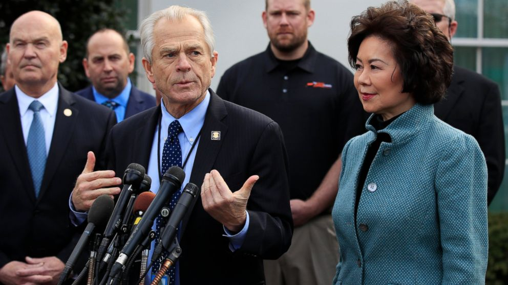 White House trade adviser Peter Navarro, front left, with Transportation Secretary Elaine Chao, right, and U.S. Maritime Administration Administrator Mark Buzby, back left, speaks to reporters outside the West Wing of the White House following President Donald Trump's signing of the executive order supporting the transition of active duty service members and military veterans into the Merchant Marine, Monday, March 4, 2019, in Washington. (AP Photo/Manuel Balce Ceneta)