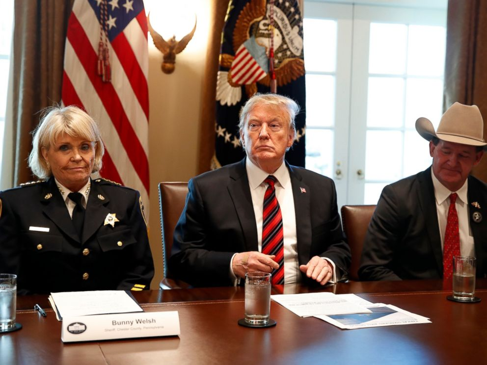 President Donald Trump, with Carolyn Bunny Welsh, sheriff of Chester County, Pa., left, and AJ Louderback, sheriff of Jackson County, Texas, attends a roundtable discussion on border security with local leaders, Friday Jan. 11, 2019.