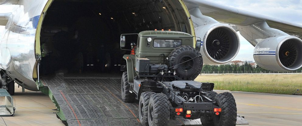 Military vehicles and equipment, parts of the S-400 air defense systems, are unloaded from a Russian transport aircraft, at Murted military airport in Ankara, Turkey, Friday, July 12, 2019. The first shipment of a Russian missile defense system has a