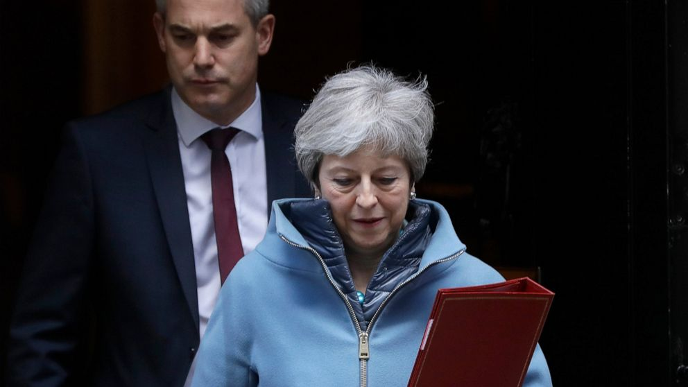 Britain's Prime Minister Theresa May and Brexit Secretary Stephen Barclay leave 10 Downing Street in London, Monday, March 25, 2019. Embattled Prime Minister Theresa May was scrambling Sunday to win over adversaries to her Brexit withdrawal plan as key Cabinet ministers denied media reports that they were plotting to oust her. (AP Photo/Kirsty Wigglesworth)
