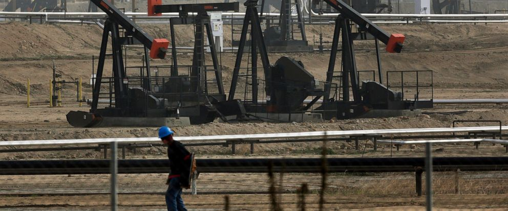 FILE - This Jan. 16, 2015, file photo shows pumpjacks operating at the Kern River Oil Field in Bakersfield, Calif. California Gov. Gavin Newsom on Saturday, Oct. 12, 2019, signed a law intended to counter Trump administration plans to increase oil an