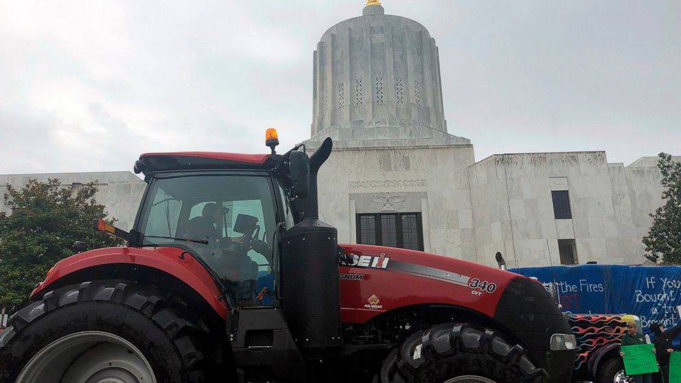 Truckers, loggers circle Oregon Capitol amid climate fight