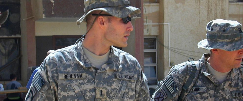 FILE - In this Sunday, Sept. 21, 2008, file photo, 1st Lt. Michael C. Behenna, left, and his defense attorney Capt. Tom Clark, right, walk in Camp Speicher, a large U.S. base near Tikrit, north of Baghdad, Iraq. The White House announced Monday, May