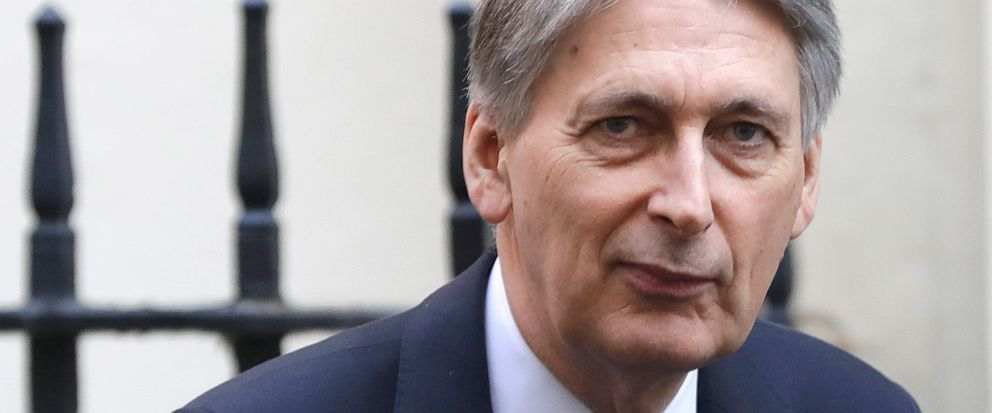 FILE - In this file photo dated Wednesday, April 10, 2019, Britains Chancellor of the Exchequer Philip Hammond in Downing Street in London. Hammond, who stepped down as Treasury chief before Boris Johnson became prime minister, has broken his silenc